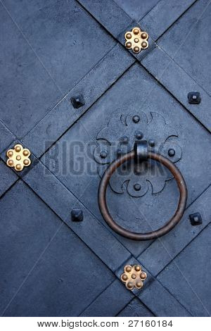 Old metal door with a gold ornament
