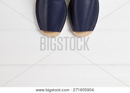 Summer Blue Sandals With White Sole On White Woooden Background. Top View, Place For Text, Copyspace