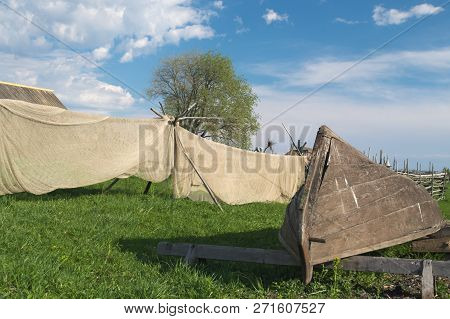 Fishing Gear. Wooden Boat And Fishing Net For Fishing In The River