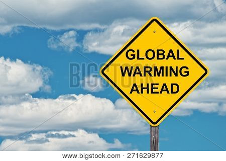 Global Warming Ahead Caution Sign With Blue Sky Background