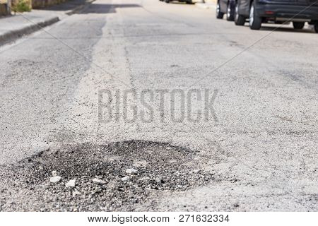 Close-up Of Damaged Street With Pot Hole
