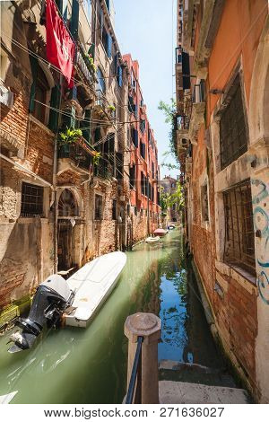 Venice, Italy - June 15, 2016: Venetial Canal And Antic Building On Sunny Day