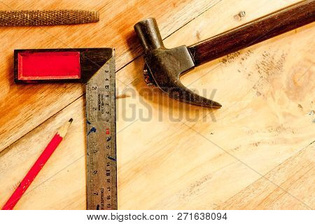 Wood Pencil And File And Solid Square And Wood Pencil And Hammer For Carpenter On Wooden Background
