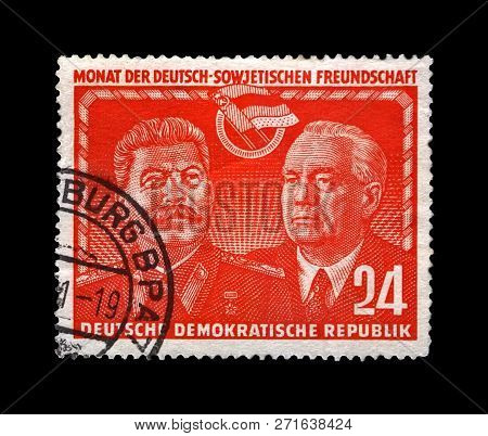 Ddr - Circa 1951: Canceled Postal Stamp Printed In Ddr Shows Joseph Stalin And Wilhelm Pieck, Famous