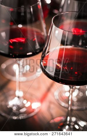 Red Wine Glass On Dark Wooden Table