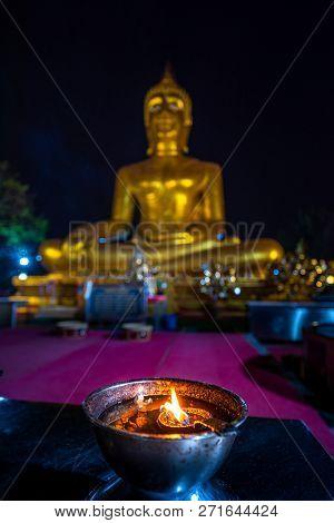 Wat Phra Yai Temple Big Buddha Selective Focus On A Candle Pattaya City Thailand