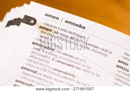 The Word Or Phrase Amen In A Dictionary Highlighted With Marker.