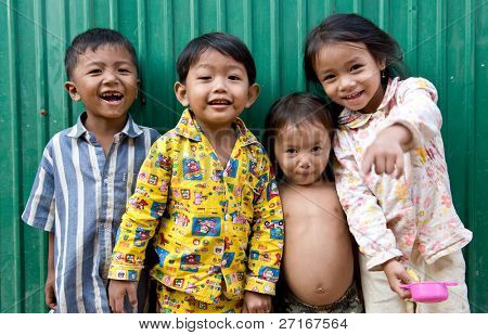 PHNOM PHEN, CAMBODIA - CIRCA JANUARY 2009: Young street children posing in Phnom Phen,Cambodia CIRCA JANUARY 2009. With widespread poverty, Cambodian street children are not a rare sight.