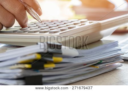 Accounting Planning Budget Concept : Accountant Hand Calculate Financial Report And Counting On Calc