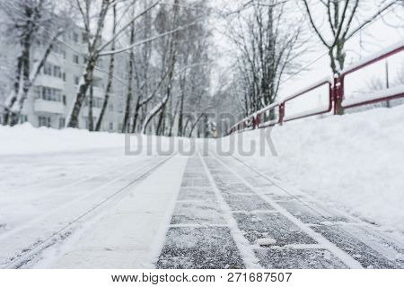 Winter Frozen Pavement Walkway Under Snow In A Park. Pavement Walkway Perspective View Abstract Wint