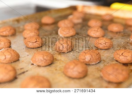 Chocolate Cookies Baked On A Cookie Sheet With Sprinkles Of Sugar.