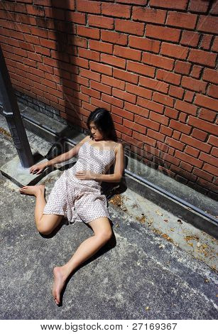 Asian girl is passed out in the gutter