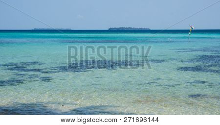 Blue Sea Narrow With Green Turqoise Color And Small Island In Distance In Karimun Jawa Indonesia