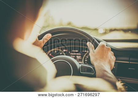 Driver And The Car. Caucasian Men Behind The Steering Wheel Of Modern Vehicle. Automotive Concept.