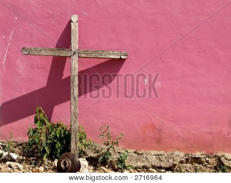 Cross Leaning On Pink Wall