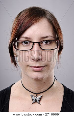 Average looking nerdy girl with spectacles in studio