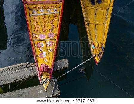 Wooden Boat On Dal Lake In Srinagar, India. The Shikara Is A Type Of Wooden Boat Found On Dal Lake A
