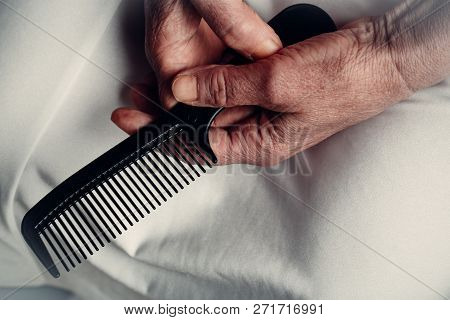 Comb For Old Woman Hair, Hair Brush With Old Hands, Brushes And Scissors. Loneliness And Nursing Hom