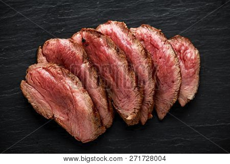 Medium Rare Venison Steak On Rustic Dark Stone Board