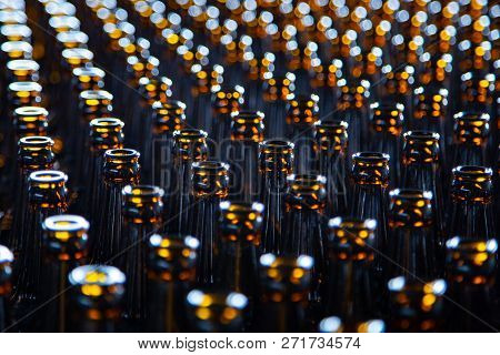 Glass Bottle Texture. Glass Bottle At Factory For Production Of Glass Containers. Many Of Transparen