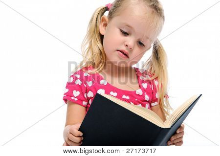 young preschool child learns while reading a book, isolated on white