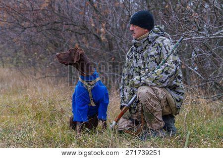 Hunter With A Dog Named Argo Gun For