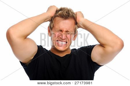Muscular blond male clenches his fists and pulls his hair out from stress