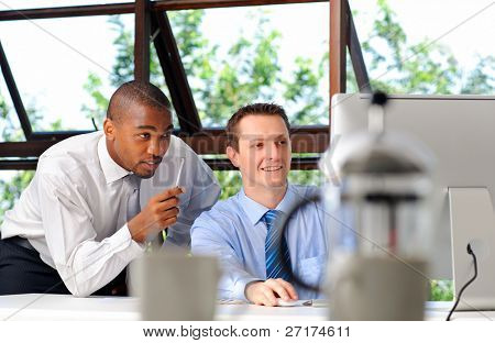 African businessman mentors his white associate on how to deal with customers effectively
