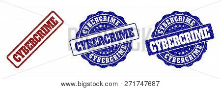 CYBERCRIME grunge stamp seals in red and blue colors. Vector CYBERCRIME watermarks with grunge texture. Graphic elements are rounded rectangles, rosettes, circles and text labels. poster