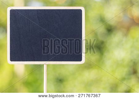 Image Of Empty Small Chalkboard Display Rectangle Label With Blurred Natural Background. Mock-up Of