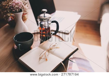 Relaxing At Home With Laptop, Hot Tea And Notebook. Cozy Weekend Morning, Modern Lifestyle.