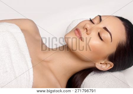 Portrait Of Young Beautiful Woman In Spa Salon.spa Body Massage Treatment And Skincare.leisure. Face