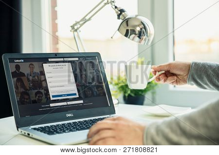 Wroclaw, Poland - November 29th, 2018: Modern Laptop On The Desk In Office With Linkedin Website On