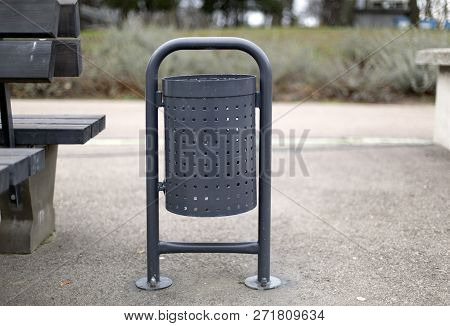 Grey Metal Steel Outdoor Trash Waste Trash Container In The Park