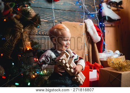 Kid Having Fun Near Christmas Tree Indoors. Hildren Gift. Christmas Kids. Christmas Tree Decoration.