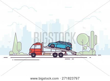 City Tow Truck On City Road. Urban Background, Skyscrapers And Buildings, Park And Trees. Emergency
