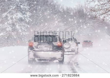 Winter, Snow, Blizzard, Poor Visibility On The Road. Car During A Blizzard On The Road With The Head