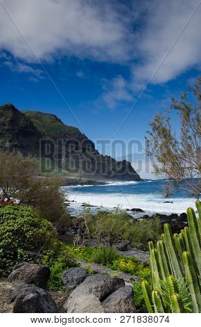 Secret View Onto The Caribbean Flair Beach With Stunning Mountain In The Background And Cactus At Th