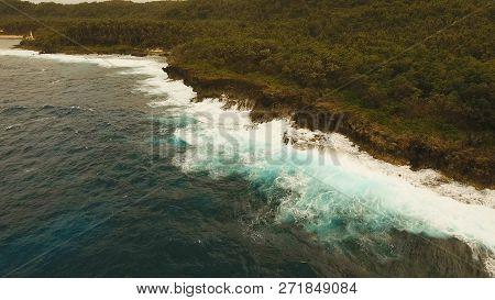 Rocky Coast Line In Time Stormy Weather On Island Siargao. Aerial View Sea Rocky Coast, Waves Breaki