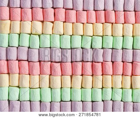 Background From Bright Multicolor Mini Marshmallow. Rows Of Sweet Zephyr. Fon From Marshmallows Clos