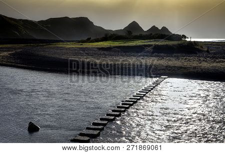 The Stepping Stones That Allow Access Over The River To The Divided Beaches At Three Cliffs Bay On T