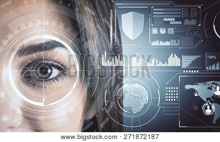 Close Up Of Woman Face With Digital Business Interface. Biometrics And Future Concept. Double Exposu