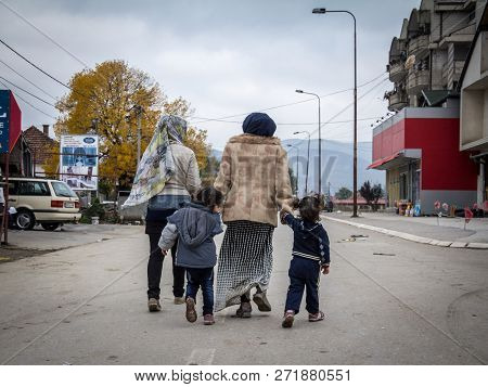 Bapska, Croatia - October 24, 2015: Two Refugee Women And Their Daughters On Their Way To Register A