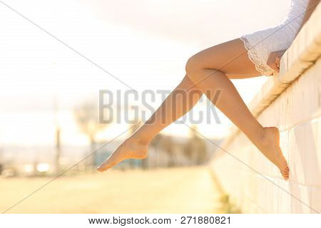 Side View Portrait Of A Perfect Woman Waxed Legs Outdoors At Sunset