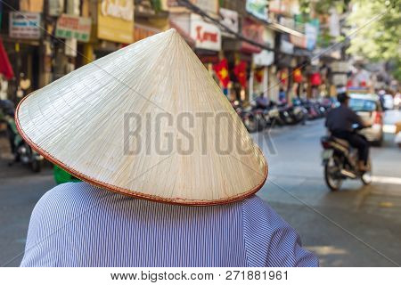 Unrecognizable Female In Traditional Hat In Hanoi, Vietnam