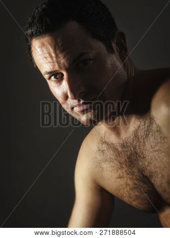 An image of a male portrait with hairy chest