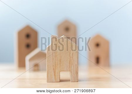 Real Estate Developer And Managing Property Investment Concept. Selective Focus Wooden Houses On Tab