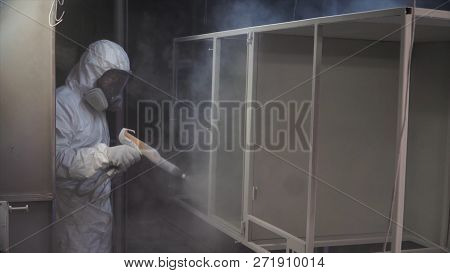 Worker At Factory Painting Metal Details With A Gun Of Powder Coating. Clip. Construction Worker Spr