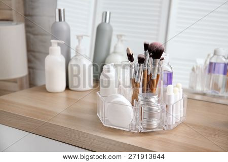 Organizer With Cosmetic Products On Wooden Table In Bathroom