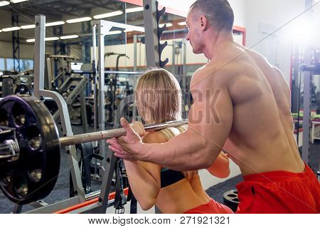 Beautiful Young Sporty Couple Workout In Gym
